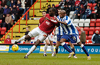 Photo: Leigh Quinnell.<br /> Bristol City v Huddersfield Town. Coca Cola League 1. 10/02/2007. Bristol Citys Enoch Showunmi has a shot on goal but is shoved by Huddersfields Frank Sinclair,