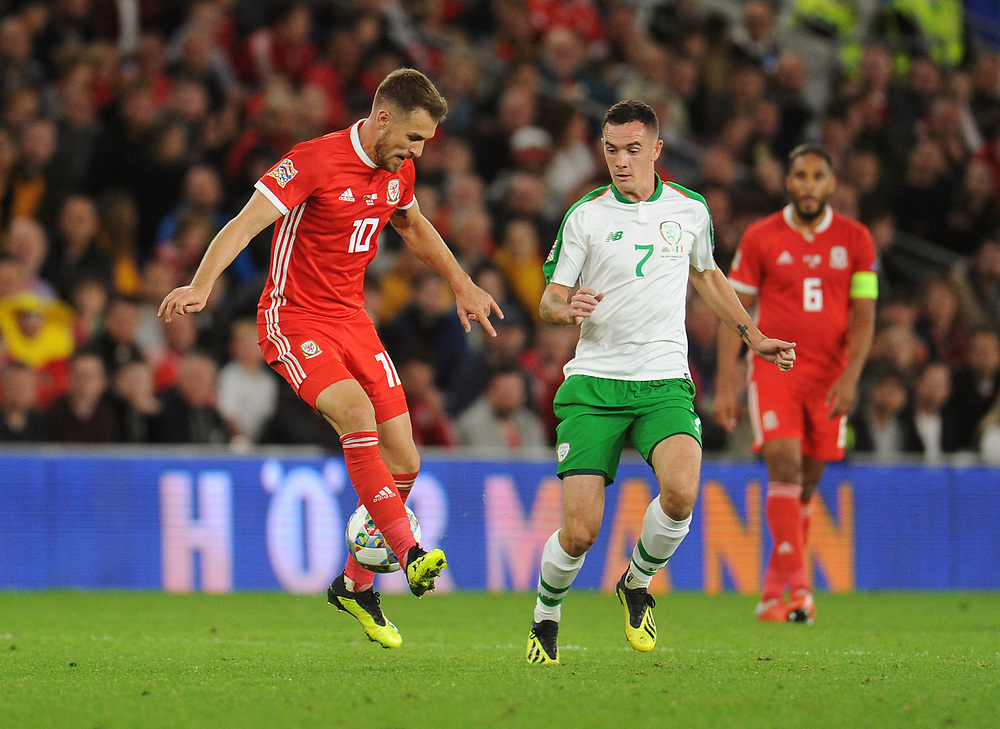 Wales' Aaron Ramsey backs heels the ball despite the attentions of Republic of Ireland's Shaun Williams<br /> <br /> Photographer Kevin Barnes/CameraSport<br /> <br /> UEFA Nations League - Group Stage - League B - Group 4 - Wales v Republic of Ireland - Thursday September 6th 2018 - Cardiff City Stadium - Cardiff<br /> <br /> World Copyright © 2018 CameraSport. All rights reserved. 43 Linden Ave. Countesthorpe. Leicester. England. LE8 5PG - Tel: +44 (0) 116 277 4147 - admin@camerasport.com - www.camerasport.com