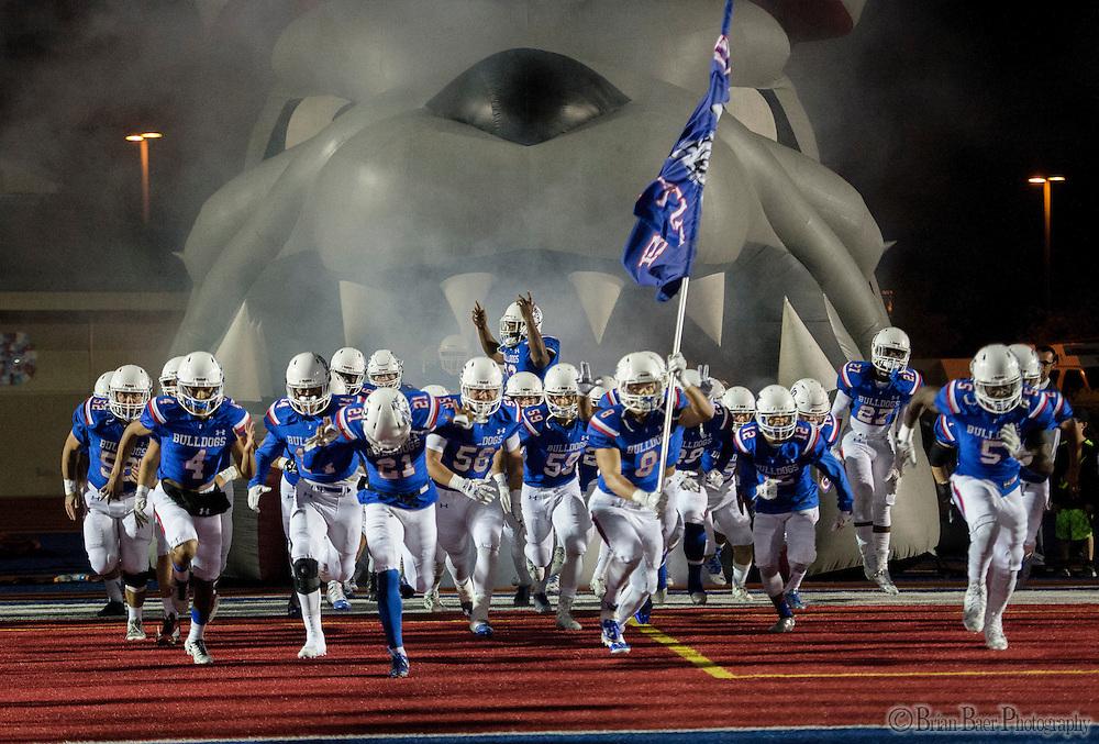The Folsom High School Bulldogs come on the to the field before the game as the Folsom High School Bulldogs varsity football team host the Oak Ridge High School Trojans,  Friday Nov 4, 2016.<br /> photo by Brian Baer