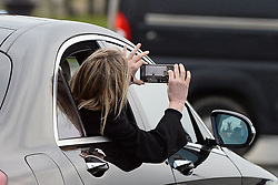 Sharon Stone is in Paris, she went to Stephane Rolland and Yves Saint Laurent, took some pictures from her car. Paris, January 28th Photo by Abacapress.com