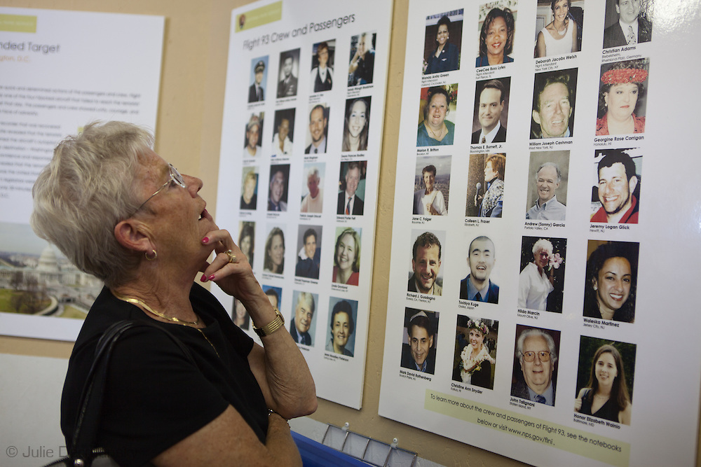 Woman looking at a plaque with photographs of  those who died on flight 93 at Flight 93 National Memorial site's temporary memorial  that overlooks the field where the flight crashed in Shanksville Pennsylvania. The temporary site will close on Sept. 9th at 4 P.M. and on Sept. 10 the official memorial will open in time for the 10th anniversary of 9/11