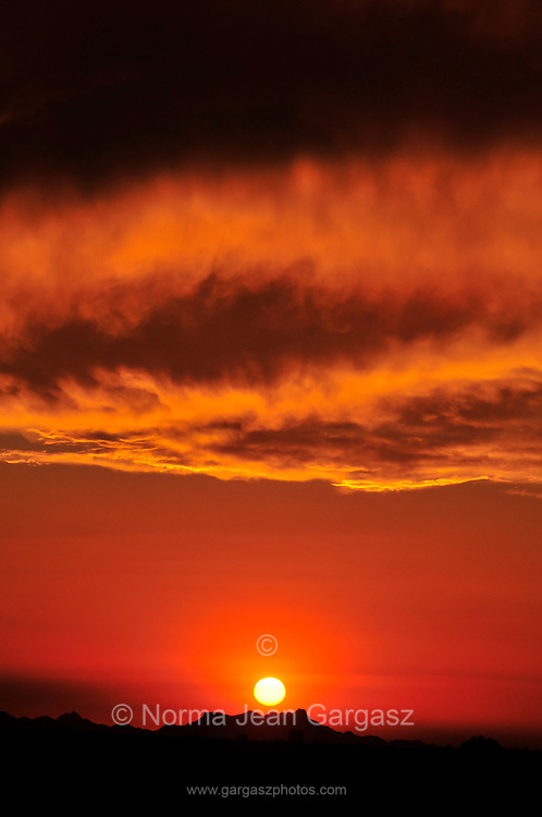 A sunset colors the sky on the first day of monsoon season in the Sonoran Desert,Tucson, Arizona, USA.