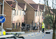 "Pictured: Audi TT smashes into house during 'police chase' before wanted men make off on foot<br /> <br /> The occupants of the house were miraculously unhurt, but the property has now been deemed unsafe and police are searching for two men who were in the car<br /> <br /> This was the scene of devastation left after a car smashed into a HOUSE during a ""high-speed police chase"", before two wanted men made off on foot.<br /> The Audi TT was left embedded in the front of a home in Portslade, Brighton, following the dramatic crash earlier this afternoon.<br /> Police say the car, which they believe to be stolen, had been clocked by detectives a short time before, and officers were looking for the vehicle when it crashed.<br /> The Sussex force said the ""precise circumstances"" of that search are being looked into, and the matter has been referred to the police watchdog.<br /> But eyewitnesses have claimed the Audi was being pursued.<br /> <br /> ollowing the crash, two men got out of the vehicle and ran away, and are now the subject of a police manhunt.<br /> A third man, who was trapped in the car, was freed by fire crews and arrested on suspicion of vehicle theft.<br /> He was also taken to hospital as a precautionary measure.<br /> The terrified occupants of the house in Valley Road, who were home when the sportscar drove through their front wall, were miraculously unhurt.<br /> But the property has been deemed unsafe by engineers, who are continuing to assess the damage.<br /> There were also reports that the front of car caught fire after the crash, but police said there are no reports that the fire spread to the house.<br /> ©Exclusivepix"