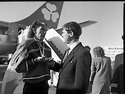 Irish Paralympic Team Arrive Home From Seoul.(R89).1988..28.10.1988..10.28.1988..28th October 1988..The Seoul Summer Paralympics 1988..The very successful Irish Paralympic team arrived home to Dublin today. The team managed a haul of 42 medals, 13 Gold, 11 Silver, 18 Bronze which earned them 19th place in the overall medal table...Paul Leisk of Cork is pictured showing his two bronze medals to the Minister of State for Youth and Sport, Frank Fahey TD.