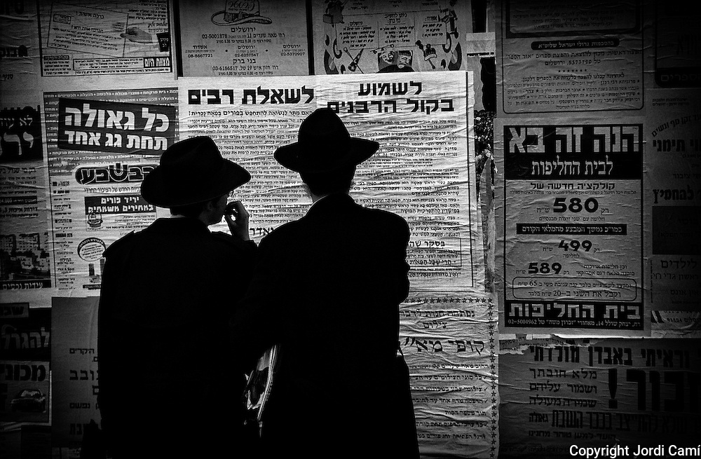 Posters with advertisements on a wall of the Mea Shearim Quarter in Jerusalem.Israel.