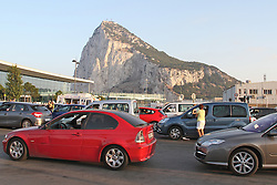 © Licensed to London News Pictures. Gibraltar Tuesday 13th Aug 2013. Held up by security checks by Spanish police and civil guardsmen, tourists and workers queued up at the Gibraltar border on Tuesday 13 August 2013. Photo credit : Donovan Torres/LNP