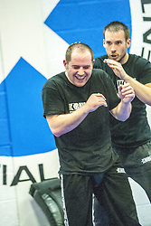 Heads during one of the exercises. Stef Noij, KMG Instructor from the Institute Krav Maga Netherlands, the IKMS G Level Programme seminar today at the Scottish Martial Arts Centre, Alloa.