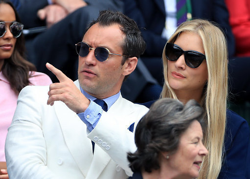 Royal Box guests Jude Law and Phillipa Coan on day eleven of the Wimbledon Championships at the All England Lawn Tennis and Croquet Club, Wimbledon.