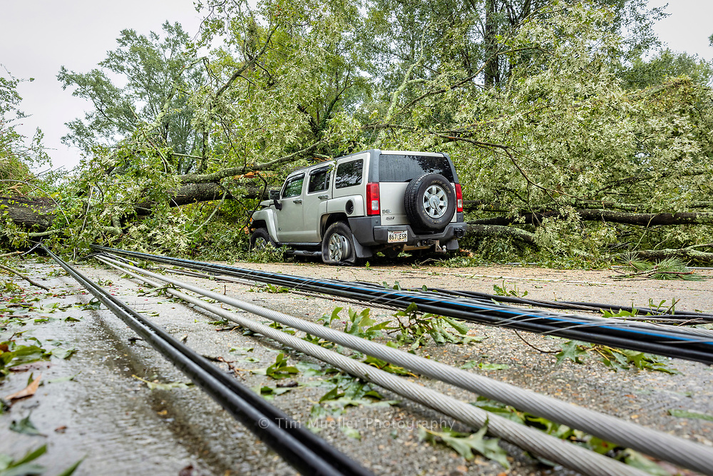 Trees and power poles knocked down by Hurricane Ida cover Old Hammond Highway in Baton Rouge, La.