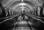 Going down the escalators, Holborn tube station.<br /> Like many other central London Underground stations, Holborn was modernised in the early 1930s to replace the lifts with escalators. <br /> Shortly after the start of The Blitz, and Holborn was partly fitted out by the City of Westminster as an air-raid shelter. Coming and Going is a project commissioned by the Museum of London for photographer Barry Lewis in 1976 to document the transport system as it is used by passengers and commuters using public transport by trains, tubes and buses in London, UK.