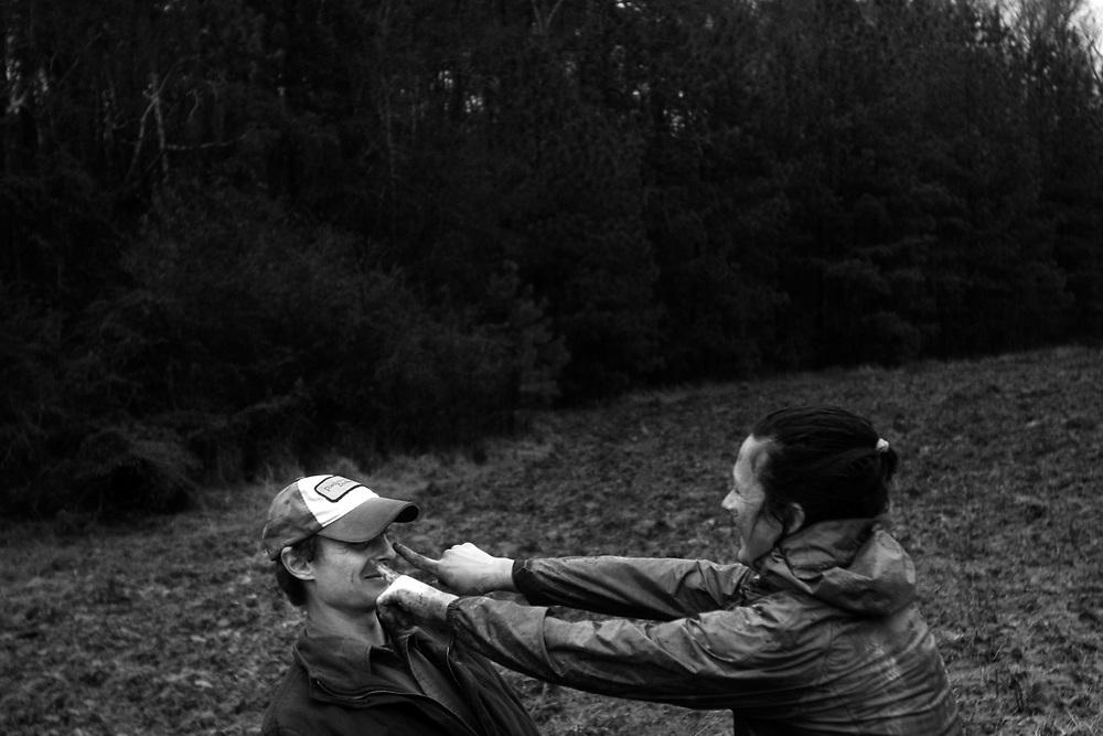 Muddy flirting. Crop mob at Eatable Earthscapes. PITTSBORO, NC - MARCH 15: Photo by LOGAN MOCK-BUNTING