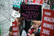 Peoples Assembly March for Health, Homes, Jobs and Education. End Austerity Now! march 16th April 2016 in London, United Kingdom. A plackard reads Trust no Tory. 50.000 thousand plus turned out to protest against the Conservative Government and their austerity policies and against tax evasions revealed in the Panama Papers.