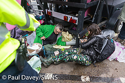 Demonstrators lock themselves to the boat trailer as Police start making arrests after issuing protesters with a Section 14 notice at an impromptu rave at Oxford Circus as hundreds of environmental protesters from Extinction Rebellion occupy Oxford Circus, a pink yacht being the focal point of their presence, with traffic denied access to two of London's busiest streets. London, April 16 2019.