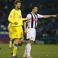 Photo: Mark Stephenson.<br />West Bromwich Albion v Leeds United. The FA Cup. 06/01/2007.<br />Leed's Tor Andre Flo (L).