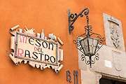 Traditional quaint sign for Meson del Rastro hotel and restaurant in Plaza del Rastro in Avila, Spain