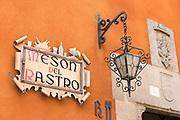 Traditional quaint sign for Meson del Rastro hotel and restaurant in Plaza del Rastro in Avila, Spain