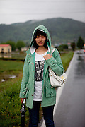 Girl walking in-between rice fields. Dajeong-ri, Jeollanam-do.  / South Korea, Republic of Korea, KOR, 23.05.2009.