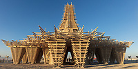 The Temple by: Marish Farnsworth and Steven Brummond from: Oakland, CA year: 2017<br /> <br /> The form of the Temple begins with life out of balance. Throughout the Sierra Nevada, species of pine trees are dying, compromised by a bark beetle which has proliferated due to human interruption of the cycle of forest fires, and climate change. The material of these trees, donated to our project, harvested and milled, becomes the basic building block of the Temple. Interlocking timber pieces in formation become a Temple that is both cloud and spire; inverted pyramidal columns suggest the negative-space of a forest canopy, simultaneously supporting a vast pagoda-like 'cloud' framework which in turn supports a central spire. In this way disorder gives way to harmony, and a group of dying trees is re-ordered into a cathedral of timbers stretching toward the sky; filtered sun rays will illuminate the intricate work of hundreds of hands building in unison; a collaboration that knits together a community as roots intertwine to give a healthy forest stability. URL: http://www.temple2017.org Contact: info@temple2017.org