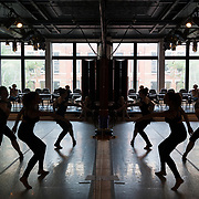 CRAIG HUDSON   Gazette-Mail <br /> Dancers are reflected in a mirror lining the wall inside the Charleston Ballet studio during a master class on modern ballet in Charleston, W.Va., on Thursday, June 22, 2017.
