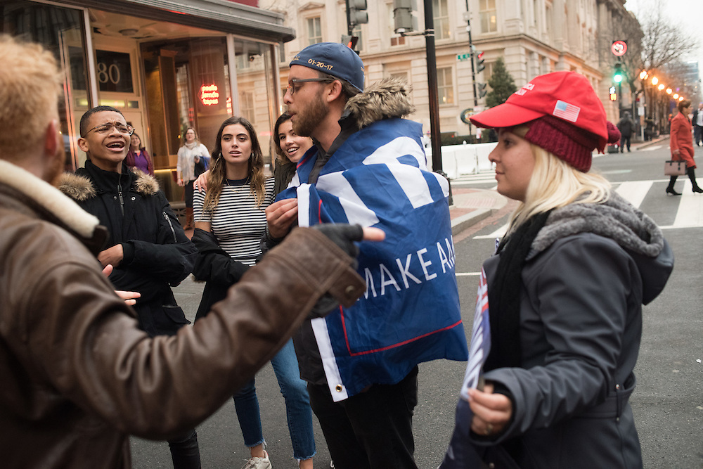 Protestor and Trump supporter debating/ arguing. Inauguration of Donald Trump and demonstrators and various entrances,  Washington DC. 20  January 2017