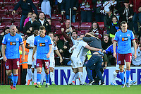 Northampton Town's Jak McCourt, left, celebrates scoring his sides equalising goal to make the score 1-1 with a spectator who joined in with the celebrations<br /> <br /> Photographer Chris Vaughan/CameraSport<br /> <br /> The EFL Sky Bet League One - Scunthorpe United v Northampton Town - Saturday 8th October 2016 - Glanford Park - Scunthorpe<br /> <br /> World Copyright © 2016 CameraSport. All rights reserved. 43 Linden Ave. Countesthorpe. Leicester. England. LE8 5PG - Tel: +44 (0) 116 277 4147 - admin@camerasport.com - www.camerasport.com