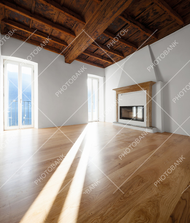 Living room with windows overlooking the lake. Fireplace. Renovated apartment with antique beams