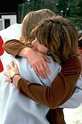 Women age 30 hugging good bye on ski vacation.  Bessemer Ironwood  Michigan USA Big Powderhorn