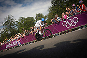 New Zealand's Jack Bauer races past fans lining the route through Bushy Park in south west London, during the London 2012 Olympic 44km men's cycling time trial, eventually won by Team GB's Bradley Wiggins.