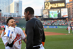 March 29, 2018 - Baltimore, MD, U.S. - BALTIMORE, MD - MARCH 29: Baltimore Orioles third baseman Manny Machado (13) hits center fielder Adam Jones (10) with a shaving cream filled towel after his walk off home run in the eleventh inning during the Opening Day game between the Minnesota Twins and the Baltimore Orioles on March 29, 2018, at Orioles Park at Camden Yards in Baltimore, MD.  The Baltimore Orioles defeated the Minnesota Twins, 3-2 in eleven innings.  (Photo by Mark Goldman/Icon Sportswire) (Credit Image: © Mark Goldman/Icon SMI via ZUMA Press)
