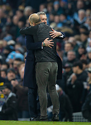 MANCHESTER, ENGLAND - Wednesday, January 1, 2020: Everton's manager Carlo Ancelotti (L) and Manchester City's manager Pep Guardiola embrace at the final whistle during the FA Premier League match between Manchester City FC and Everton FC at the City of Manchester Stadium. Manchester City won 2-1. (Pic by David Rawcliffe/Propaganda)