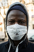 "March, 26th 2020 - Paris, Ile-de-France, France: Parisians wearing a range of masks and facial coverings in the hope of protecting themselves from the spread of the Coronavirus, during the eigth day of near total lockdown imposed in France. A week after President of France, Emmanuel Macron, said the citizens must stay at home from midday on Tuesday for at least 15 days. He said ""We are at war, a public health war, certainly but we are at war, against an invisible and elusive enemy"". All journeys outside the home unless justified for essential professional or health reasons are outlawed. Anyone flouting the new regulations is fined. Nigel Dickinson"