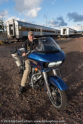 Pilot extraordinaire Dave Przygocki (he has ridden Michael Lichter backwards more than 11,000 miles on 3-Cannonballs, parked by the Grand Canyon Railroad in Williams, AZ during the Motorcycle Cannonball Race of the Century. Stage-12 ride from Page, AZ to Williams, AZ. USA. Thursday September 22, 2016. Photography ©2016 Michael Lichter.