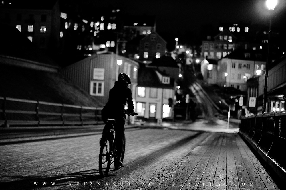 I have taken this photo on a coldd but beautiful night in Trondheim Norway over an old bridge called gamlebybro. I was on my knees and waited for a nice moment. The place is always crowded but I was lucky enough to capture this unique moment. I have not edited this photo except a little brightness.