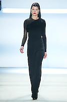 Julia van Os walks the runway wearing Cushnie et Ochs Fall 2016, hair by Antonio Corral Calero for Moroccanoil, makeup by Val Garland, photographed by Thomas Concordia during New York Fashion Week on February 12, 2016