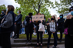 "© Licensed to London News Pictures. 10/05/2021. Manchester, UK. A protester holds a placard calling for "" Cops of campus "" . Students at the University of Manchester protest and march through Manchester City Centre , over their living and learning conditions . The occupation of the University's Samuel Alexander building by students continues , as demonstrators say they have been let down over fees and rental charges under Coronavirus , the actions of police and private security on campus and the University's responses to students' concerns , over the last twelve months . Photo credit: Joel Goodman/LNP"