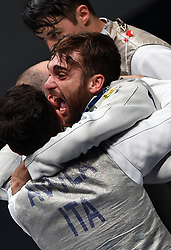 WUXI, July 27, 2018  Daniele Garozzo (C) of Italy celebrates with his teammates after winning the men's foil team final between Italy and the United States at the Fencing World Championships in Wuxi, east China's Jiangsu Province, July 27, 2018. Italy beat US 45-34 and claimed the title of the event. (Credit Image: © Han Yuqing/Xinhua via ZUMA Wire)