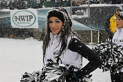 A Philadelphia Eagles Cheerleader looks on in the snow during the NFL game between the Detroit Lions and the Philadelphia Eagles on Sunday, December 8th 2013 in Philadelphia. The Eagles won 34-20. (Photo by Brian Garfinkel)