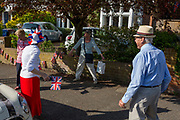 As the Coronavirus lockdown continues over the May Bank Holiday, the nation commemorates the 75th anniversary of VE Day (Victory in Europe Day, the day that Germany officially surrendered in 1945) and in Dulwich, neighbours and residents emerge from their homes to party while still observing social distancing rules. Local residents joke about social distancing before together singing the wartime morale-raising songs of Dame Vera Lynn: 'White Cliffs of Dover' and 'We'll Meet Again', on 8th May 2020, in London, England.