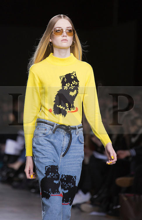 © Licensed to London News Pictures. 18 February 2014, London, England, UK. Collection by Ashley Williams. A model walks the runway at the Fashion East show during London Fashion Week AW14 at the Topshop Showspace/Tate Modern. Photo credit: Bettina Strenske/LNP
