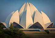The Lotus Temple, located in New Delhi, India, is a Bahá'í House of Worship completed in 1986. Notable for its flowerlike shape, it serves as the Mother Temple of the Indian subcontinent and has become a prominent attraction in the city. The Lotus Temple has won numerous architectural awards and been featured in hundreds of newspaper and magazine articles