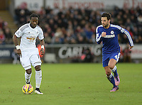 Swansea City's Marvin Emnes vies for possession with Chelsea's Cesc Fabregas<br /> <br /> Photographer /Ashley CrowdenCameraSport<br /> <br /> Football - Barclays Premiership - Swansea City v Chelsea - Saturday 17th January 2015 - Liberty Stadium - Swansea<br /> <br /> © CameraSport - 43 Linden Ave. Countesthorpe. Leicester. England. LE8 5PG - Tel: +44 (0) 116 277 4147 - admin@camerasport.com - www.camerasport.com