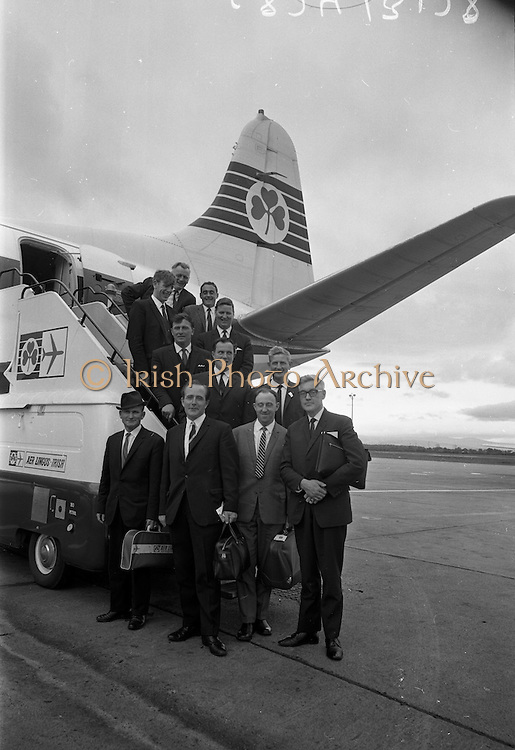 16/07/1967<br /> 07/16/1967<br /> 16 July 1967<br /> Fishermen leave on market research visit to Britain from Dublin Airport. Representatives from Killybegs, Dingle; Kilmore Quay and Castletownbere went on the trip to Fleetwood and Grimsby.  Picture shows the fishermen boarding the aircraft with Mr. T.F. Geoghegan (front, 2nd left) Market Development Manager of BIM; Mr Noel O'Mahoney, (front, 3rd left), Field Officer BIM and Mr J.M. O'Connor (front right) the Board's Advisory Services Manager. Included are Mr Ml. Rogers and Mr M. Moore of Killybegs; Mr M. Kane and Mr T. Devane of Dingle; Mr J. Power and Mr J. Hayes of Kilmore Quay and Mr F. Downey and Mr D. O'Driscoll of Castletownbere.