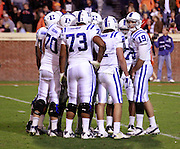 CHARLOTTESVILLE, VA- NOVEMBER 12: The Duke Blue Devil huddle on the field during the game against the Virginia Cavaliers on November 12, 2011 at Scott Stadium in Charlottesville, Virginia. Virginia defeated Duke 31-21. (Photo by Andrew Shurtleff/Getty Images) *** Local Caption ***
