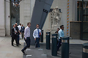 Employees return to work after a lunchtime break <br /> in Leadenhall Street, on 12th September, in the City of London, UK.