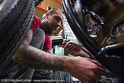 Jordan Dickinson working on his BF6 Knucklehead while other builders worked on their bikes at Noise Cycles the night before Born Free 6. Santa Ana, CA. USA. June 26, 2014.  Photography ©2014 Michael Lichter.