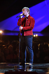 EDITORIAL USE ONLY.<br /><br />Ed Sheeran performs on stage at the Brit Awards at the O2 Arena, London.