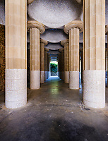 BARCELONA, SPAIN - CIRCA MAY 2018: Doric Columns and Tiles in Parc Güel. Parque Güell is a public park system composed of gardens and architectonic elements located on Carmel Hill, in Barcelona, Catalonia, Spain. It was designed by Antoni Gaudi and it is a popular tourist destination.