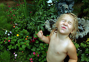 A child plays in the garden.