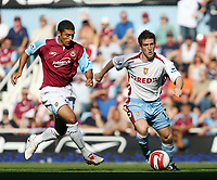 Photo: Chris Ratcliffe.<br /> West Ham United v Aston Villa. The Barclays Premiership. 10/09/2006.<br /> Steven Davis of Aston Villa clashes with Hayden Mullins of West Ham.