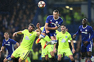 John Terry, the Chelsea captain (c) jumps to head the ball at goal from a corner. The Emirates FA cup, 3rd round match, Chelsea v Peterborough Utd at Stamford Bridge in London on Sunday 8th January 2017.<br /> pic by John Patrick Fletcher, Andrew Orchard sports photography.